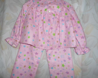 Girls size 4 Pajamas with green purple pink blue stars on pink