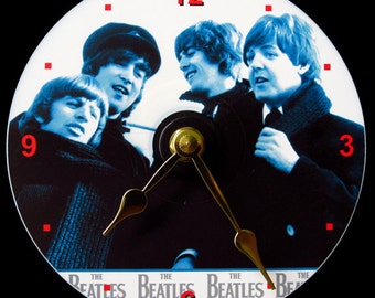 New BEATLES Wall CLOCK - CD Size! 4.75 inch diameter. John Lennon, Paul McCartney, George Harrison, Ringo Starr. Fab 4. Makes a nice gift!