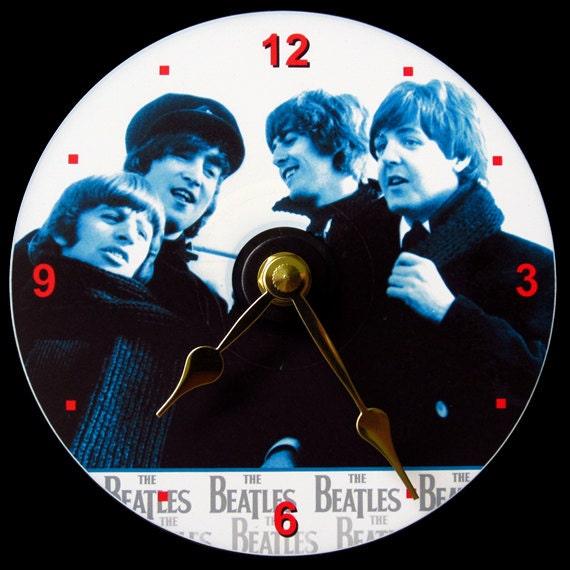 New BEATLES Wall CLOCK - CD Size! 4.75 inch diameter. John Lennon, Paul McCartney, George Harrison, Ringo Starr. Fab 4. Makes a nice gift!