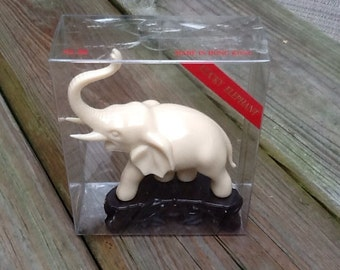 1960's dime store lucky elephant plastic ivory simulated statue.