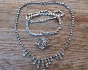 Vintage rhinestone necklace, two bracelets and a brooch
