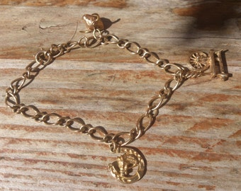 Vintage 9ct gold charm bracelet with three charms
