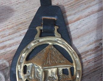 Vintage horse brass on leather strap