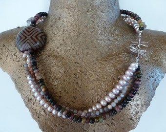 Three strands - pale pink pearls - dusky tourmalines - Botswana agates - an earthy Kenyan Kasuri pendant and a silver dragonfly hook clasp
