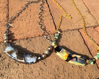 Curved focal bead necklace