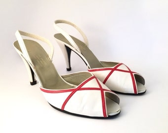 CHRISTIAN DIOR!!! Striking 1980s 'Christian Dior' white leather peep toe sling-backs with red criss cross design / Made in France