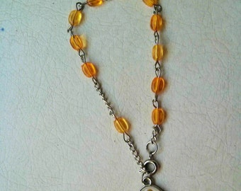 Vintage collection - Rosary  style yellow plastic beads and saint medallion bracelet