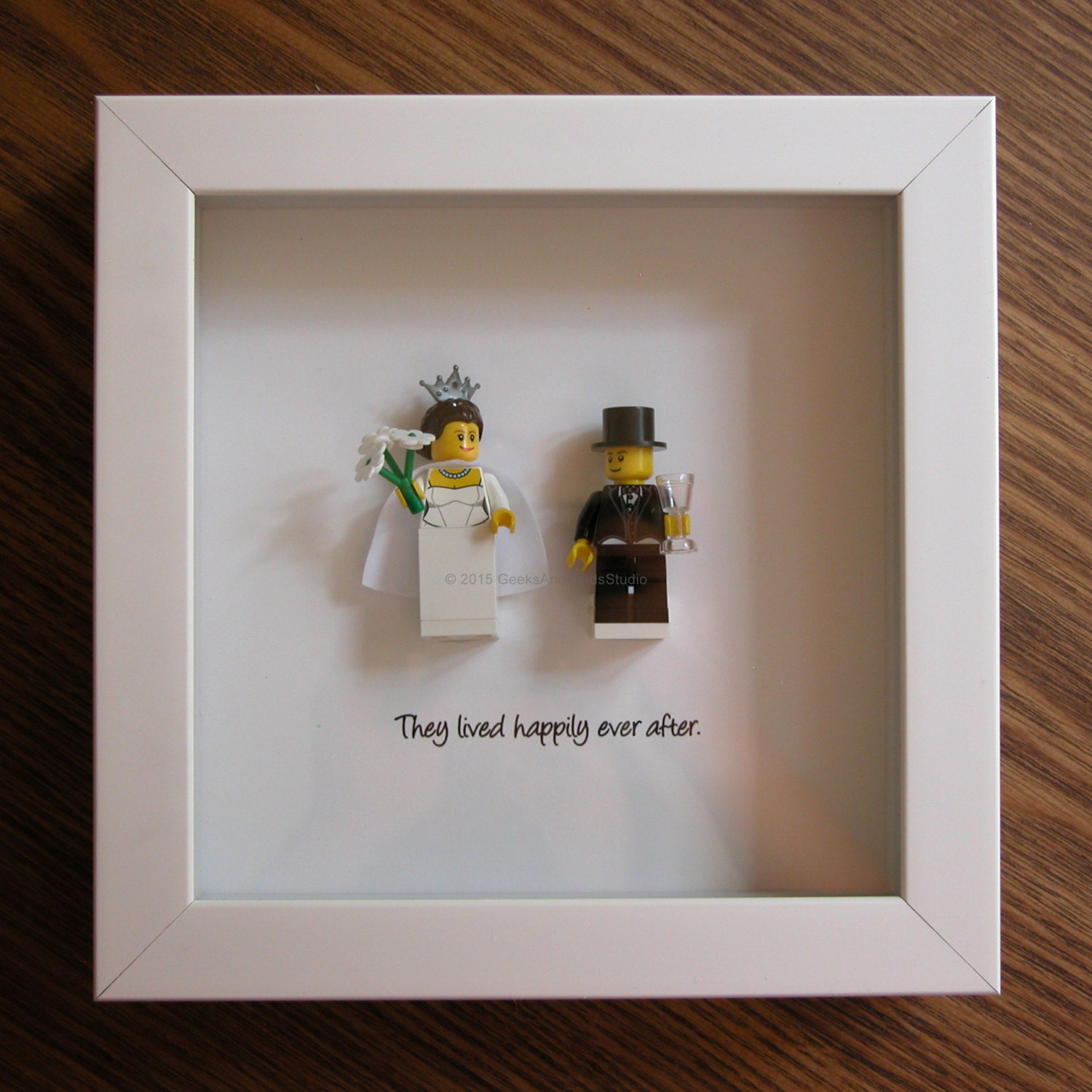 Wedding reception centerpieces with picture frames wedding daze august wedding centerpiece lego art frame bride groom junglespirit Choice Image
