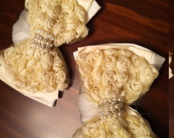 Ivory rosette bows