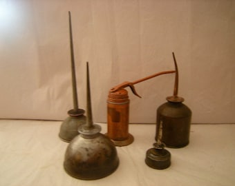 5 oil cans-1 pump can-pitted oil cans-collection-garage-man cave-rustic-
