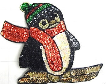 Sequin and Beaded Penguin Skiing - JJX686L-box33; JJX686SM-box39