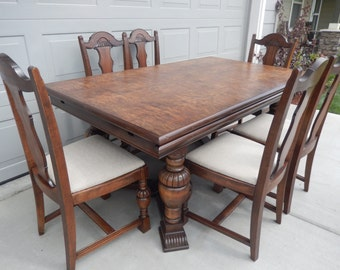Hold for Elizabeth Stothal.  Please do not purchase.  DINING ROOM TABLE and Six Chairs