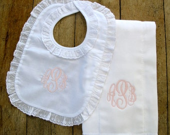 Baby bib with sweet eyelet trim