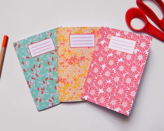 Three notebooks A 6 Japanese paper patterns, lined sheets