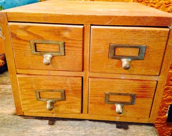 Vintage four drawer library card catalog cabinet. Awesome piece of vintage home decor.