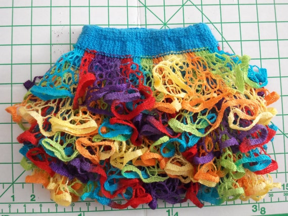 Baby or toddler ruffled skirt. Bright multicolor with turquoise waistband.