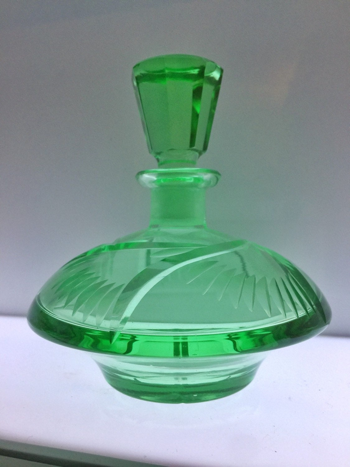vintage green cut glass perfume bottle
