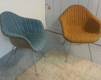 A PAIR of 1969 Herman Miller Eames shell chairs with Alexander Girard striped material!