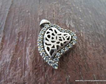 Silver pendant heart covered with shiny beautiful crystals on sides
