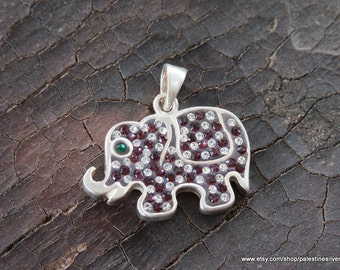Silver pendant elephant shape covered with shiny beautiful green,red, and crystal crystals