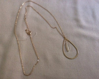 """Teardrop crystal nugget on gold chain 32"""""""