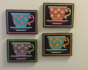 Completed cross stitch magnets