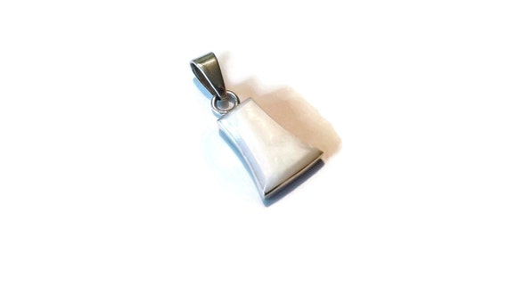 A vintage sterling silver pendant with gorgeous mother-of-pearl.
