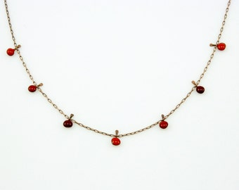 Handmade enameled necklace; 3 shades of tiny red droplets on a copper chain.