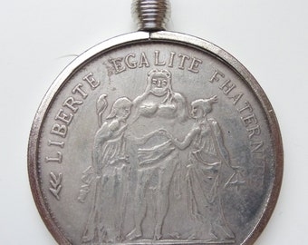 Interesting old replica coin - French 10 Franc in coin pendant holder