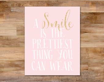 A smile is the prettiest thing you can wear - pink and gold sparkle - inspirational quote