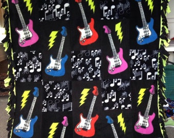 GUITARS and MUSICAL NOTES Fleece Blanket