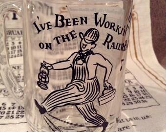 "Peanut Butter Glass Mug Big Top Peanut Butter Promotional Mug ""I've Been Workin On The Railroad"" Glass Song Lyric Mug - 1950s Hazel Atlas"