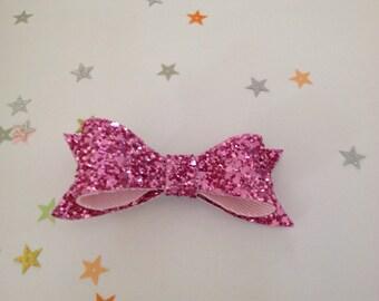Pink glitter bow hair clip.