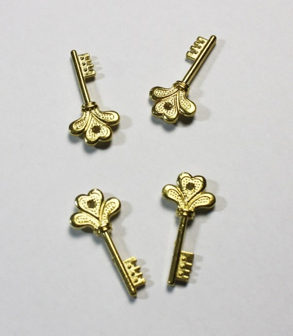 Art deco golden charms costume jewelry necklaces for Art deco costume jewelry
