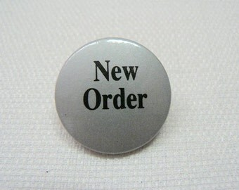 Vintage Early 80s New Order Pin / Button / Badge - Black Logo on Silver Background