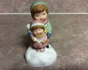A Boy and Girl Singing 'Joy To The World' Figurine Christmas Music Box, Avon.