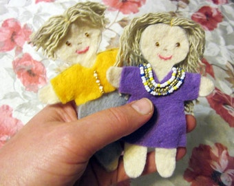 Two felt dolls -- brown-haired boy and girl -- small dolls -- felt people