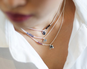 Sterling silver Bird necklace with Red Garnet