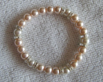 Lace...a stretch bracelet.  Pink and white pearls with rhinestone rondelle spacers.
