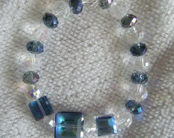 Louisa...a stretch bracelet.  Blue and clear crystal beads in a variety of shapes.