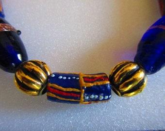 African Krobo and cobalt blue Czech glass beaded bracelet, ethnic, trade, hippie, boho, red, yellow, blue