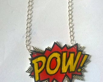 "Hand drawn ""POW"" shrink plastic necklace."