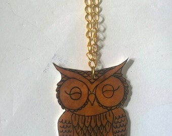 Hand drawn brown owl shrink plastic necklace.