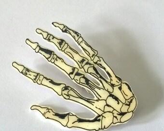 Hand drawn skeleton hand brooch.