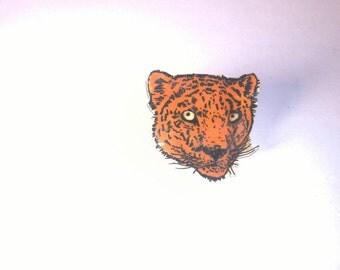 Hand drawn leopard face shrink plastic brooch.