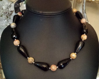 One strand black onyx and faceted crazy agate