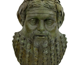 Bronze mask of Dionysos God of winemaking and wine
