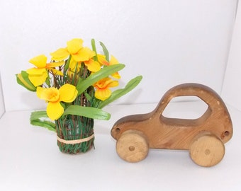 Vintage. Wooden car for play or decoration. Made of natural hard wood. A gift for a child. Wooden car. Wooden toy. Wooden decor. Gift.