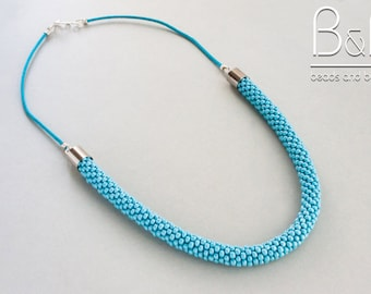 Blue crochet beaded rope necklace.
