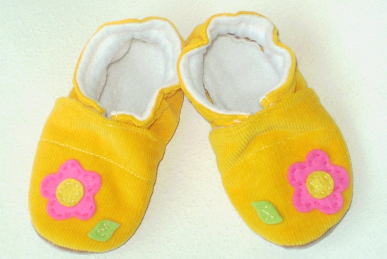 Tiny baby shoes might just be the cutest, most irresistible baby accessory to buy. But until your little one starts walking, they're not absolutely necessary. Now's the time to stick with those tiny grippy socks or leave their toes free for wiggling.